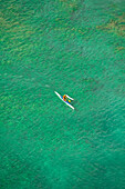 Hawaii, Oahu, Waikiki, Aerial view of local man in an Outrigger Canoe. (EDITORIAL USE ONLY)
