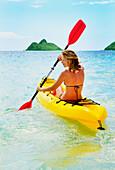 Hawaii, Oahu, Lanikai =, Female kayaker enjoying a day on the water.