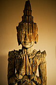 Close-up on a wooden Buddha sculpture (Sepia photograph).
