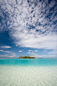 French Polynesia, Tuamotu Islands, Rangiora, Turquoise water and blue skies surround isolated isalnd.