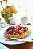 Hawaii, Maui, Balcony, Breakfast fresh fruit waffle and coffee.