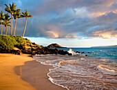 Hawaii, Maui, Makena, Secret Beach at sunset.