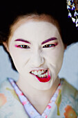 Portrait of Japanese Maiko making a funny face.