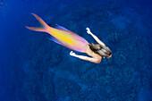 This mermaid and ocean scene was created digitally to create a human mermaid.