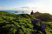 Hawaii, Oahu, Lanikai, Woman hiker admiring view of Mokulua Islands.