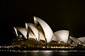 Australia, Sydney, A night scene looking across Sydney Harbor to the iconic Opera House.