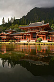 Hawaii, Oahu, Ahuimanu Valley, Valley of the Temples, Byodo-In Temple and reflection in pond, Mountains in background.