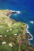 Hawaii, Lanai, Manele golf course along coastline, aerial.