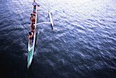 Hawaii, Oahu, Ala Wai Canal, Men paddling an outrigger canoe, motion blur, view from above NO MODEL RELEASE