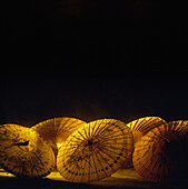 Thailand, Oriental umbrellas, golden colors, black background