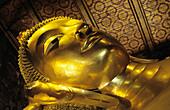 Thailand, Bangkok, Wat Po Close-up of gold Reclining Buddha head