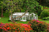 Hawaii, Lanai, Hulopoe Beach, Koele Ladge, Orchid House among flowers and trees.