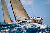 Hawaii, Kenwood Cup, Wave in foreground of crew sitting on yacht starboard side