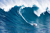 Hawaii, Maui, Jorge Martinez surfs huge wave at Jaws aka Peahi.