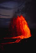 Hawaii, Big Island, Kilauea Volcano fountaining at 700 feet, red lava in the night sky.
