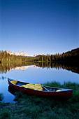Oregon, Cascade mountains, Canoe at Scott Lake, Three Sisters mountain reflections background B1657
