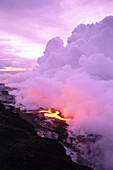 Hawaii, Big Island, Hawaii Volcanoes National Park, lava entering ocean at dawn, purple smoke billows C1632