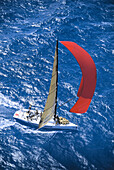 Florida, Miami, Short Ocean Racing Championship (SORC), Aerial view of yacht with sails blowing in wind, cutting through water