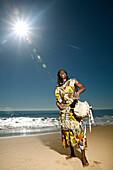 Hawaii, Kauai, Kealia Beach, African dancer on shore with drum.