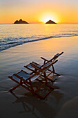 Hawaii, Lanikai, Empty beach chair at sunset.