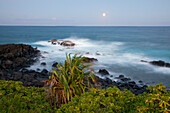 Hawaii, Maui, Hana, The moon rising over soft ocean.