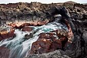 Hawaii, Maui, Makena, Ocean water moving through a lava tube.