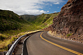 Hawaii, Maui, A winding road through Maui's west side with lush mountains.