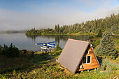 USA, Alaska, Prince William Sound, Shrode Lake, float plane parked by US Forest Service cabin.