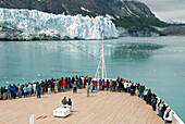 United States, Alaska, Inside Passage, Glacier Bay National Park, passengers on cruise ship viewing the glaciers.