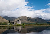 United Kingdom, Scotland, Kilcurn Castle on a peninsula at the end of Loch Awe, Castle reflecting in water.