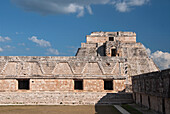 Mexico, Yucatan, Uxmal, Cuarangulo de las Monjas (Nuns Quadrangle), eastern side (foreground), Casa del Advino (Magician's House) in background