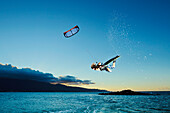 Hawaii, Maui, Kiteboarder gets airborne at sunset. EDITORIAL USE ONLY.