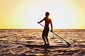 Hawaii, Maui, Wailea, Stand Up Paddeling at Sunset.