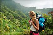 Hawaii, Kauai, Napali Coast, Woman Hiking on the Napali Coast Trail.