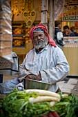 'Man Selling Vegetables In Market Stall; Delhi, India'