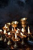 'Boudhnath, Kathmandu, Nepal; Candles Burning In A Row'