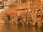 'The Ganges, Varanasi, India;People Bathing And Relaxing In And Around The River'