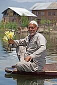 Man On Boat Holding Flowers