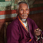 'Senior Male Praying At Chimi Lhakhang Monastery; Punakha District Bhutan'