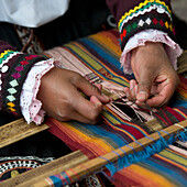 'Hands Weaving Colorful Fabric; Cusco Peru'