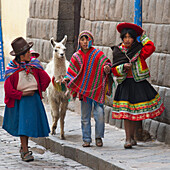 'A Woman With Her Son And Daughter Walk With A Llama; Cusco Peru'