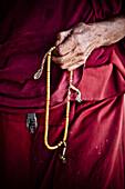 'An Old Buddhist Monk Counts Prayer Beads; Ladakh Jammu And Kashmir India'