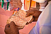 'A Man Holds Paper With Red Text Reading In Worship; Haridwar India'