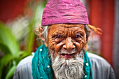 'An Elderly Muslim Man Wearing A Pink Prayer Cap; India'