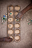 'Playing A Game With Marbles; Senegal'