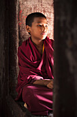 'Portrait Of A Young Monk In A Red Robe; Kathmandu Nepal'