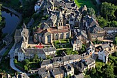 France, Corrèze (19), Uzerche village bati around the abbey of Saint-Pierre, situated on a rocky promontory overlooking a bend in the Vezere (aerial photo)