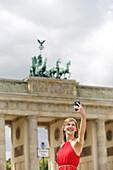 Pretty blonde woman doing sightseeing in Berlin
