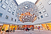 Huge spiral ball suspended above the courtyard, sphere sculpture by Olafur Eliasson, Fuenf Hoefe, Munich, Upper Bavaria, Bavaria, Germany