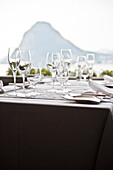 Set table in the restaurant of Hotel Castagnola, Lake Lugano, Lugano, Ticino, Switzerland